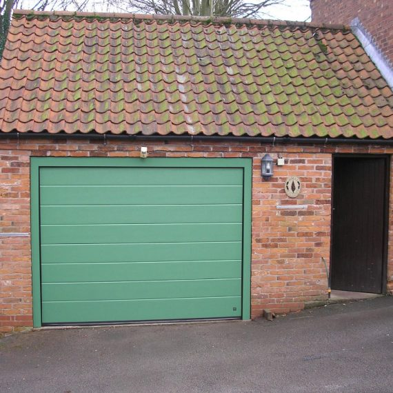 suburb green garage doors